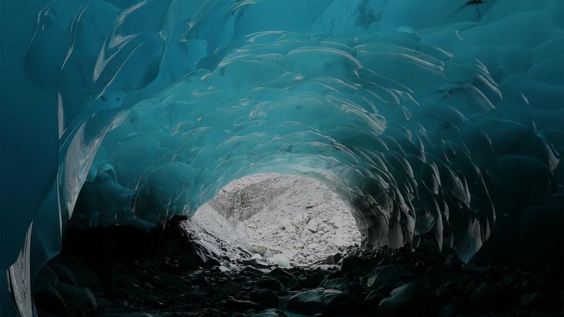 Inside a blue-green ice cave.